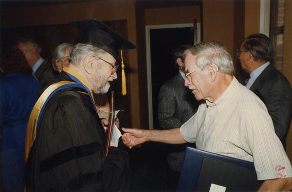 Marion Zeitlen and Robert Vosper speak at gathering for PhD Hooding Ceremony, June 1988