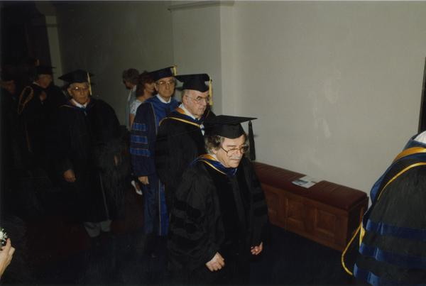 Bertram Russell, Russell O'Neill, Morley English and Isadore Rudnick line up for PhD Hooding Ceremony, June 1988