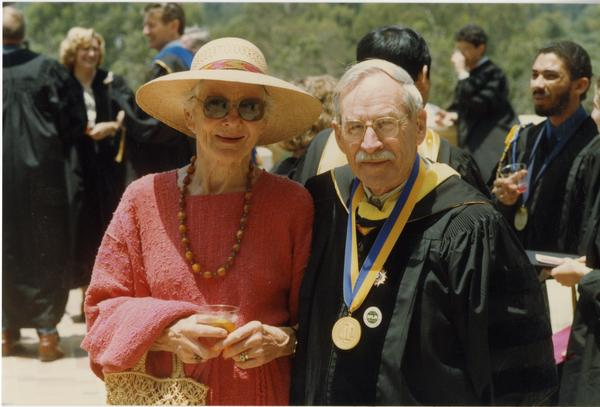 Mr. and Mrs. Robert Vosper stand outside Royce Hall after PhD Hooding Ceremony, June 1988