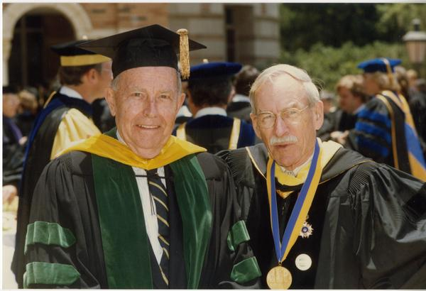 Franklin Murphy and Robert Vosper stand outside Royce Hall after PhD Hooding Ceremony, June 1988