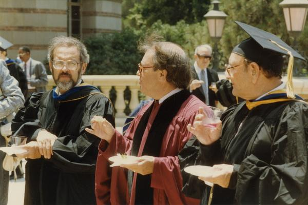 Lewis Solmon and Bert Raven speak to unidentified man outside of Royce Hall, June 1988
