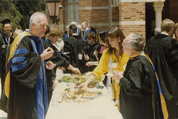 Robert Hayes, Tati Wennekamp and others gather around buffet table during Robing Reception, June 1988