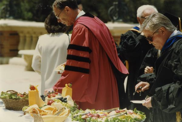 Henry Kelly at buffet table during Robing Reception, June 1988