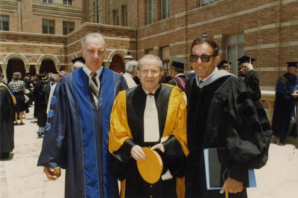 Elwin Svenson, Wolf Leslau and Marvin Alkin stand outside Royce Hall during Robing Reception, June 1988