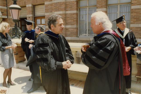 Raymond Orbach and Lewis Nosanow speak outside of Royce Hall during Robing Reception, June 1988