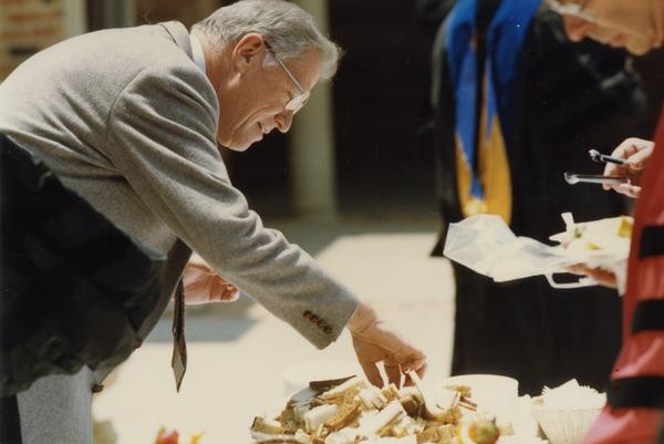 Chancellor Young picking out a sandwich at Robing Reception, June 1988