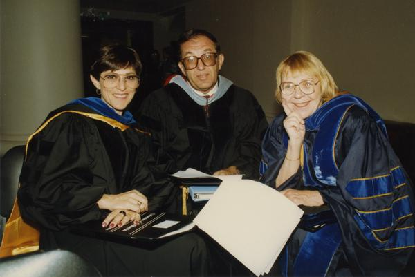 Andrea Rich, Marvin Alkin and Victoria Fromkin sit together before the PhD Hooding Ceremony, June 1988