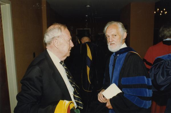 Franklin Murphy and Paul Farrington talk before PhD Hooding Ceremony, June 1988