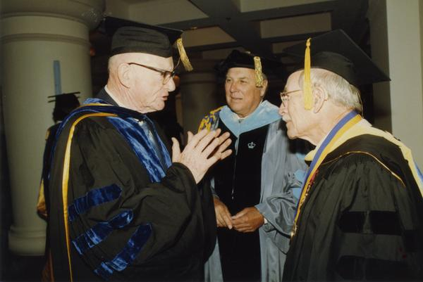 Kenneth Bailey, Norman Miller and Robert Vosper chat before the PhD Hooding Ceremony, June 1988