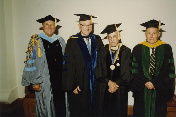 Norman Miller, Kenneth Bailey, Robert Vosper and Franklin Murphy gathered before the PhD Hooding Ceremony, June 1988