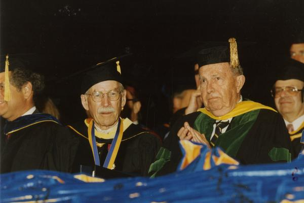 Robert Vosper and Franklin Murphy seated on stage during PhD Hooding Ceremony, June 1988
