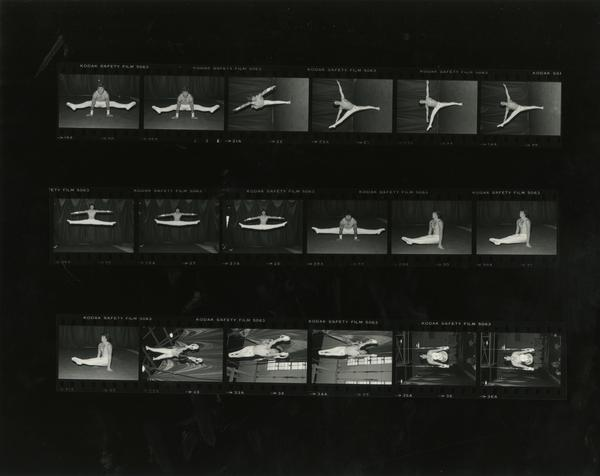 Contact sheet of Men's Gymnastic Team in action poses, November 1981
