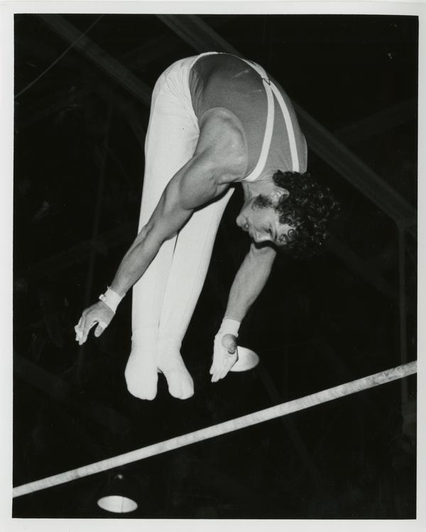UCLA gymnast Jerry Montooth on high bar