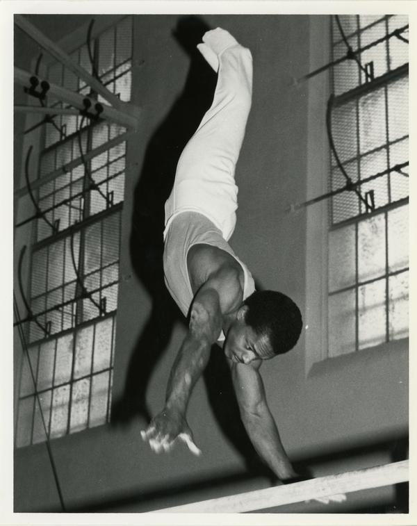 UCLA gymnast Carlos Spivey on parallel bars