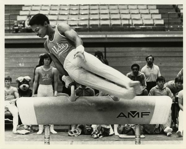 UCLA gymnast performing on pommel horse