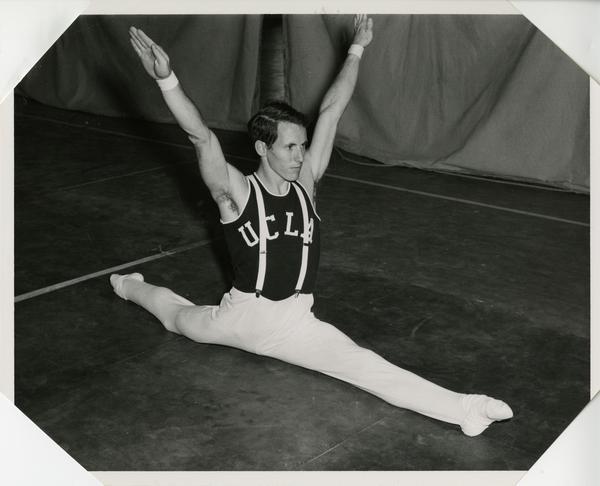UCLA gymnast performing splits
