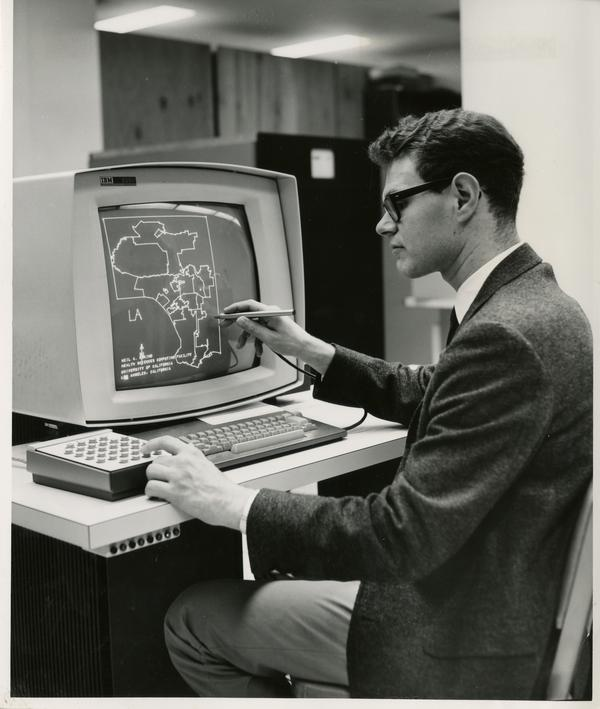 Man looks at epidemiological map on computer