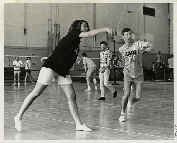 Students playing badminton, ca. 1965