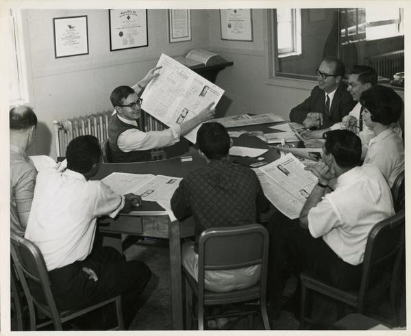 Class critiquing newspaper