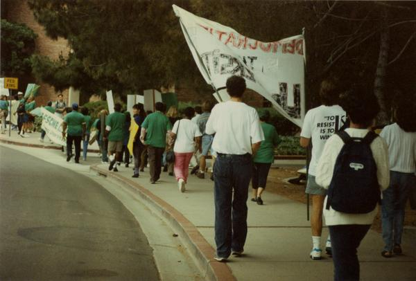 Participants march along street during Labor Union Rally, 1993