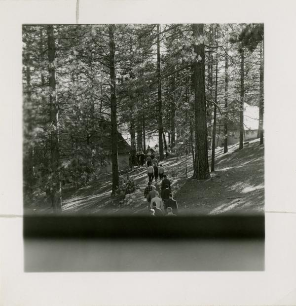 Group walks along trail at Lake Arrowhead Lodge, March 1959