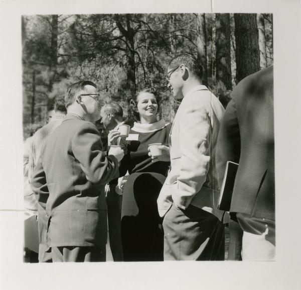 Group of three stand in conversation during a coffee break at Lake Arrowhead Lodge, March 1959