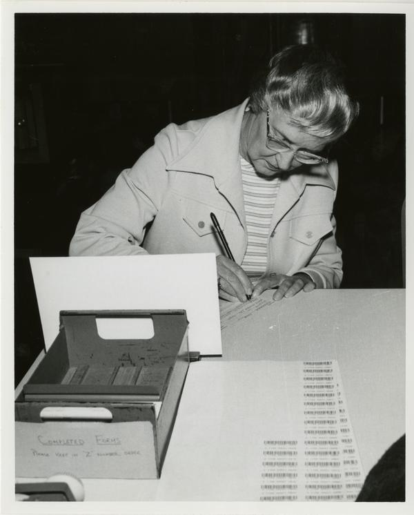 Page Ackerman filling out form