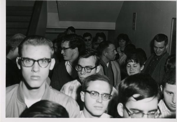 Crowd waiting in stair well for 1962 sale of library duplicates