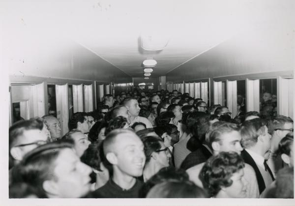 Crowd in hallway for 1962 sale of library duplicates