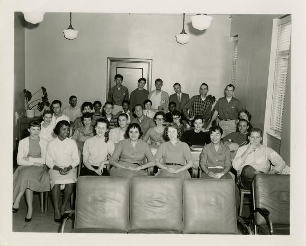 Portrait of Library circulation staff, ca. 1958