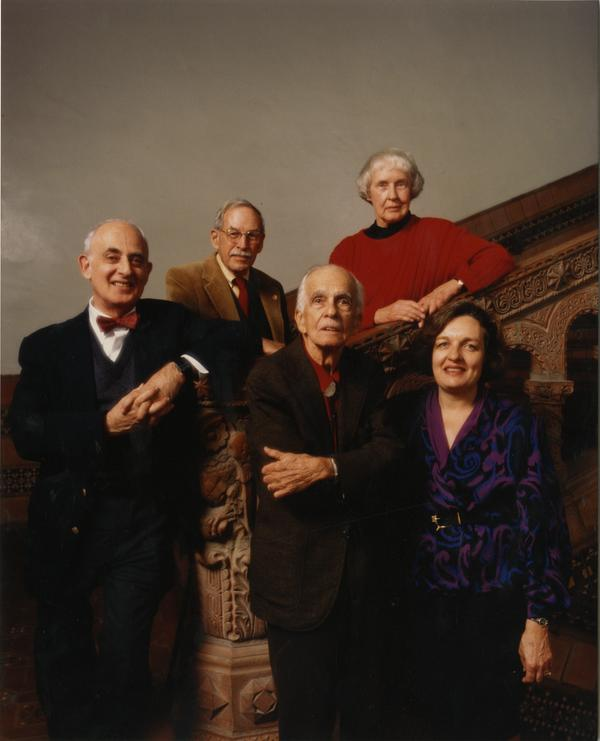 University Librarians posing at Powell Library central staircase: Gloria Werner, Bob Vosper, Russell Shank, Lawrence Clark Powell, and Page Ackerman, ca. 1989