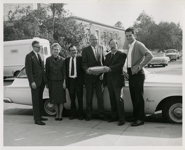 Ernest Moore, Esther Euler, John E. Smith, Whelon Voigt, and Robert Vosper at arrival of the intercampus shuttle, ca. january 1951