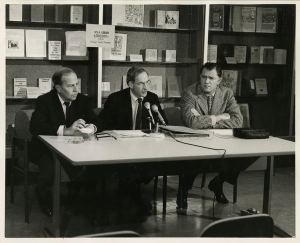F.D. Murphy, R. Vosper, and C.E. Young speaking at three millionth book accession press conference
