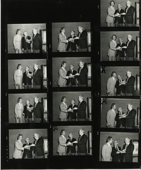 contact sheet of Robert Eckert, Russell Shank, and David Rodes looking at the five millionth volume, May 21, 1983