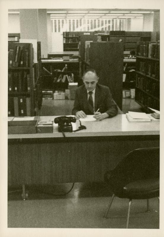 Reference Librarian sitting at desk
