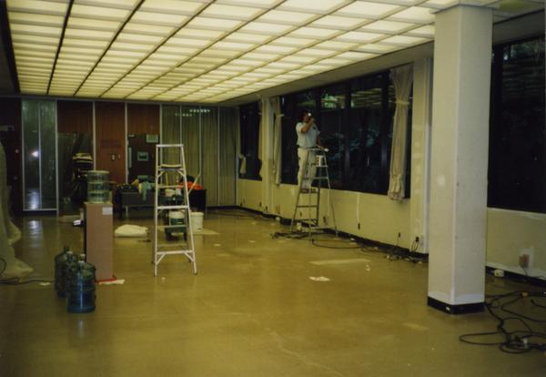 Worker on ladder during Library Special Collections renovation