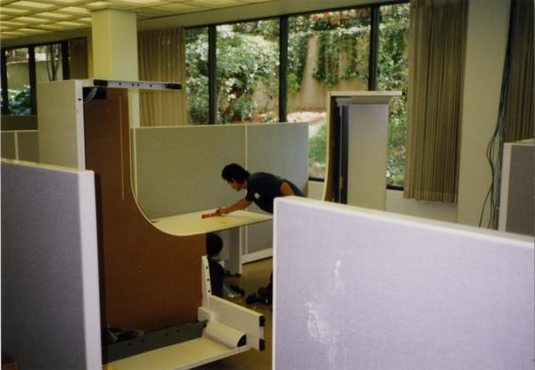 Worker builds cubicles for Library Special Collections renovation
