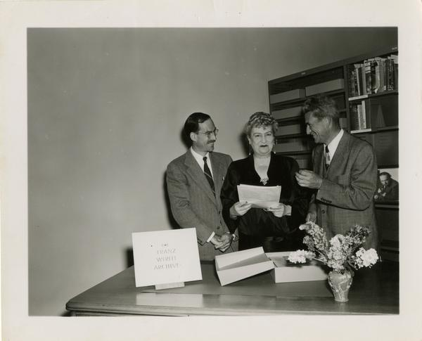 Robert Vosper, Mrs. Franz Werfel, and Gustave O. Arlt meeting in regards to Franz Werfel Archive