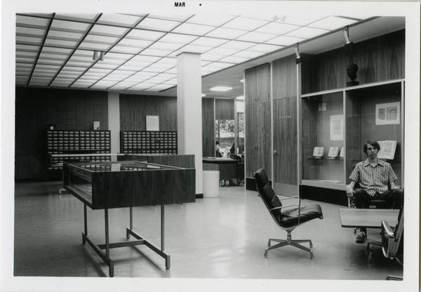 Patron sits in Library Special Collections reference area, ca. March 1976