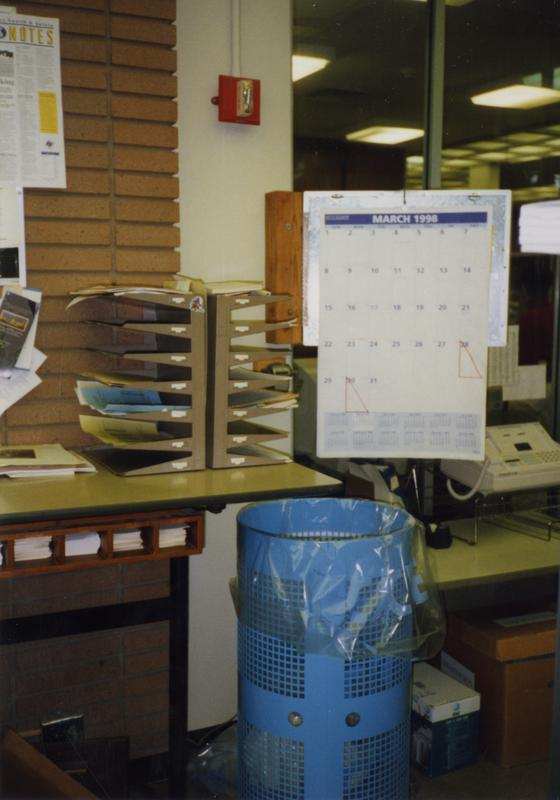 View of calendar and mailboxes in Library Special Collections staff area, ca. March 1998