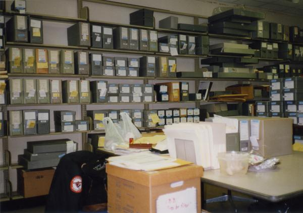 Shelves housing archival materials in Library Special Collections staff area, ca. 1997