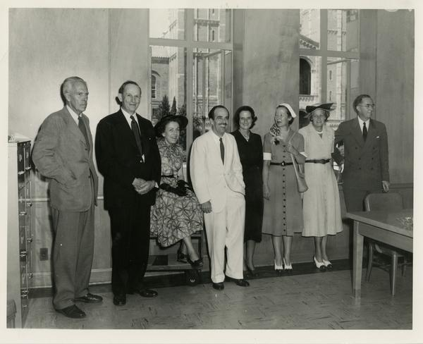 Group photo with Lawrence Clark Powell ain center during Library Special Collections dedication, July 28, 1950