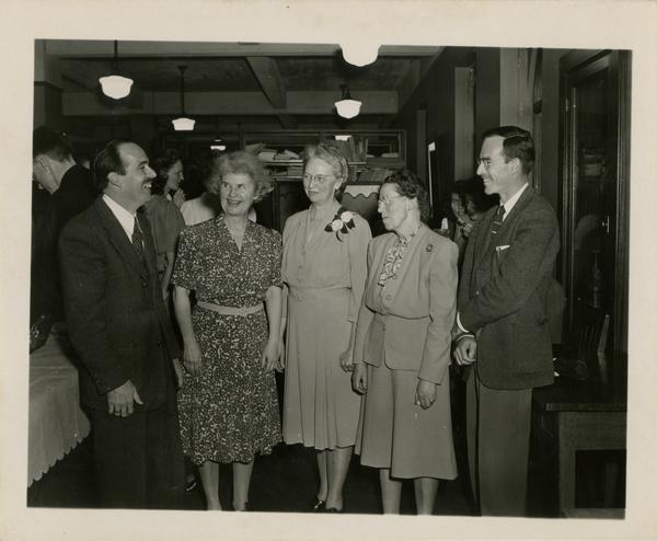 Library staff photo with Lawrence Clark Powell, Mrs Bryan, James Coldren Goodwin, Miss Hamiston, and Robert Vosper at Fanny Coldren retirement party, ca. 1946