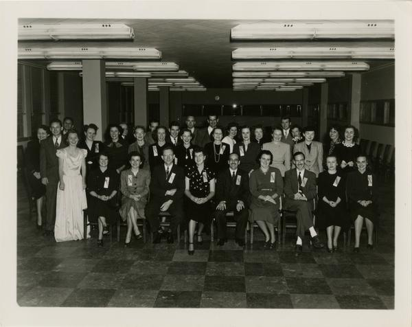 Library staff group portrait with Lawrence Clark Powell seated in center of front row