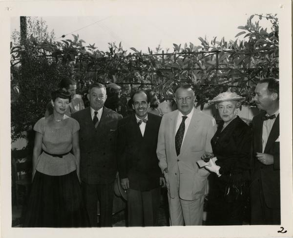 Group portrait of Mary Horn, Regent E. Dickson, Lawrence Clark Powell, Will Robinson, and Mrs Dickson
