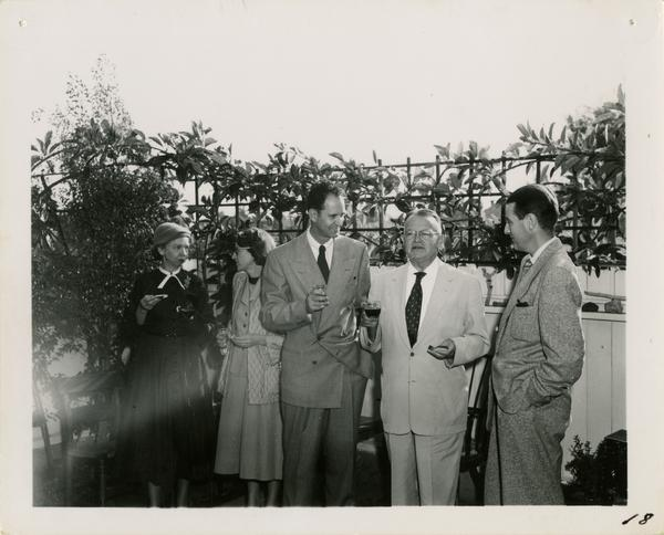 Photo of Irene Robinson, Ninon J. Smith, Richard Archer, Will Robinson, and Wilbur Smith at party