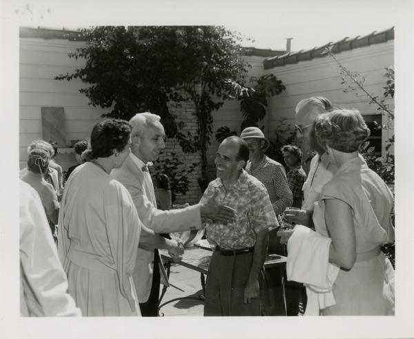 Lawrence Clark Powell greeting guests