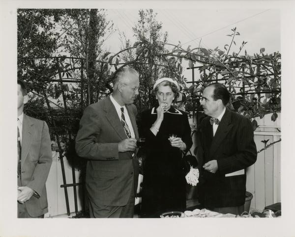 Lawrence Clark Powell with guests at party