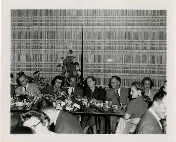 Page Ackerman, Lawrence Clark Powell, Mrs. Elmer Belt, and Chancellor Allen at Library staff Christmas party, December 19, 1957