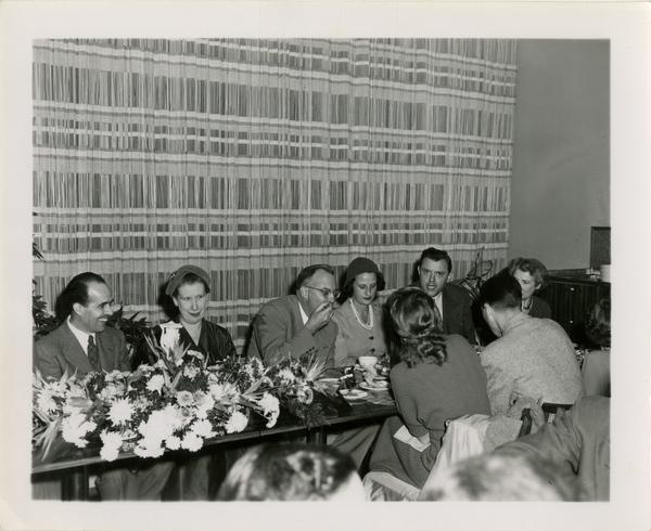 Lawrence Clark Powell, Mrs. Elmer Belt, Chancellor Allen and other staff at Library staff Christmas party, December 19, 1957